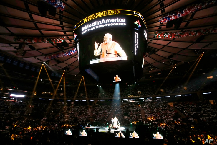 Prime Minister Narendra Modi of India gives a speech during a reception by the Indian community in honor of his visit to the United States at Madison Square Garden, Sunday, Sept. 28, 2014, in New York. (AP Photo/Jason DeCrow)
