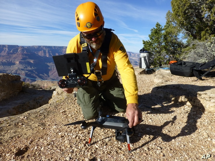 A Grand Canyon National Park employee operates a drone at the park in 2016. The Grand Canyon is the only national park with its own fleet of unmanned aircraft for reaching people who have gotten lost, stranded, injured or killed.