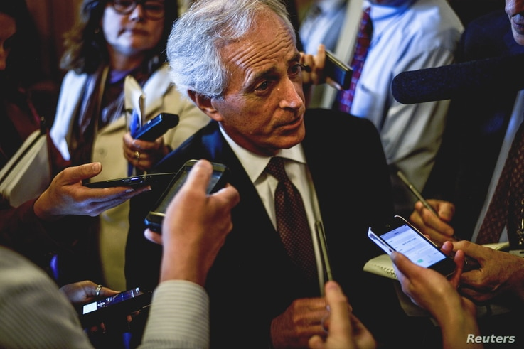 Senator Bob Corker speaks to reports at the US Capitol in Washington, April 21, 2015.