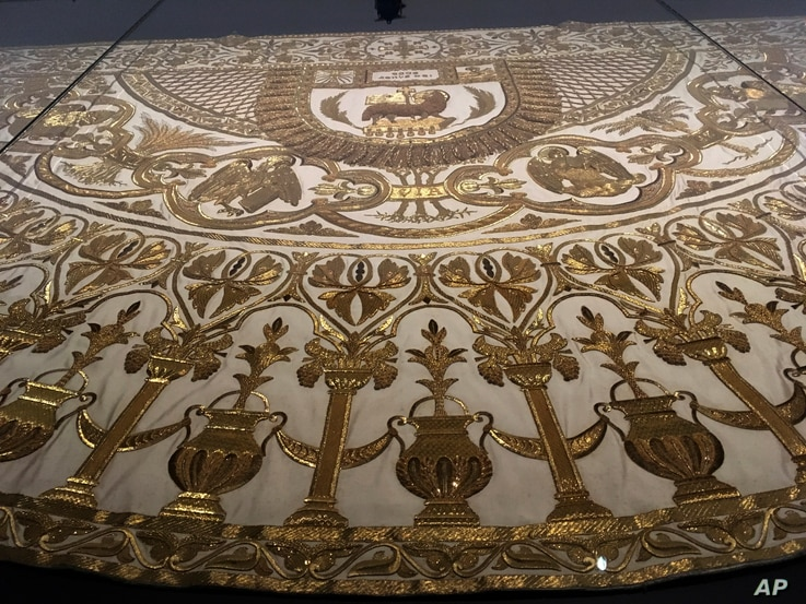"A detail from a papal mantle from the Sistine Chapel sacristy at the Vatican is on display at the Metropolitan Museum of Art in ""Heavenly Bodies: Fashion and the Catholic Imagination,"" the Spring fashion exhibit at the museum's Costume Institut..."