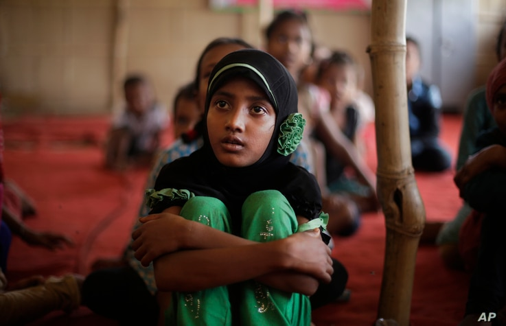Children of Rohingya refugees attend a temporary school run by a non-governmental organization at a camp for Rohingyas in New Delhi, India, Aug. 16, 2017.