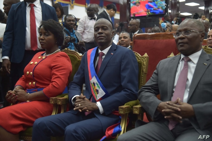 New Haitian President Jovenel Moise(C) sits after receiving his sash, during his Inauguration, at the Haitian Parliament in Port-au-Prince, on Feb. 7, 2017.