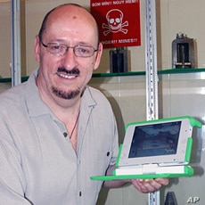 Professor Frank Biocca, one of the game's developers, holds a One Laptop Per Child Computer during his recent trip to assess the game's effect on learning about the dangers of landmines (File)