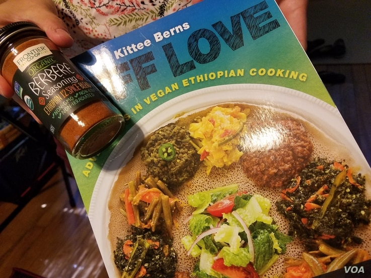 A vegan cookbook with recipes from the Ralbovsky's foster son's current country is a hopeful nod to the couple's plans for activities that blend their lives with the teenager's. Greenbelt, Maryland, July 11, 2017. (VOA/A. Arabasadi)