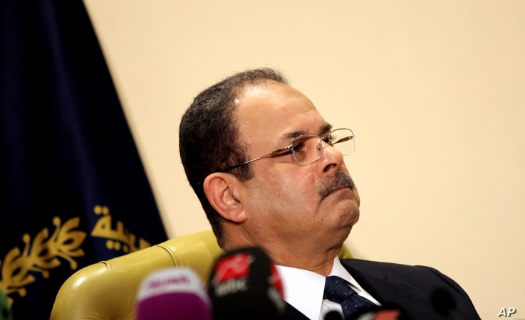 "FILE -- Egyptian Interior Minister Magdy Abdel-Ghaffar appears live on state and private television, in Cairo, Egypt, March 6, 2016. Abdel-Ghaffar warned of a ""conspiratorial scheme"" by the now-banned Muslim Brotherhood to incite chaos, in comme..."