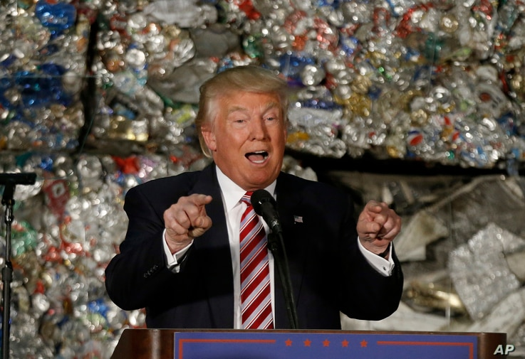 FILE - Then-presidential candidate Donald Trump speaks during a campaign stop at Alumisource, a metals recycling facility in Monessen, Pa., June 28, 2016. Trump has broken with decades of conservative economic thinking on the value of free trade.