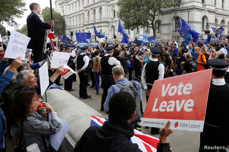 "FILE - Brexit supporters form a counter demonstration as Pro-Europe demonstrators protest during a ""March for Europe"" against the Brexit vote result earlier in the year, in London, Britain, Sept. 3, 2016."