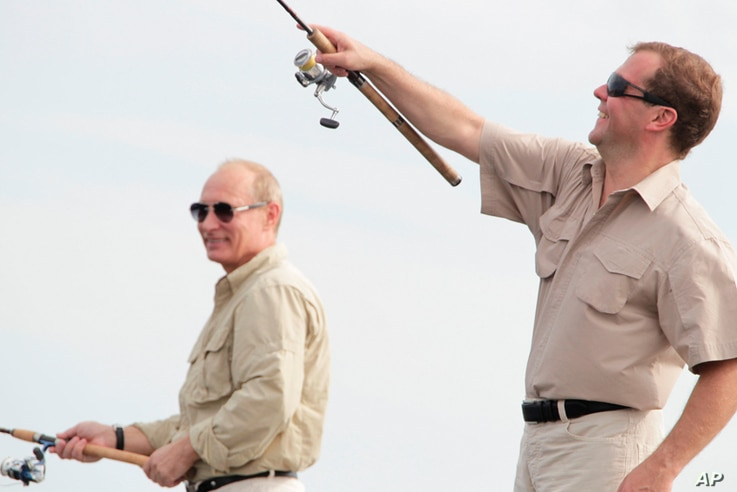 Dmitry Medvedev and Prime Minister Putin enjoy some fishing on the river Volga in Russia's Astrakhan region August 16, 2011. (Reuters)
