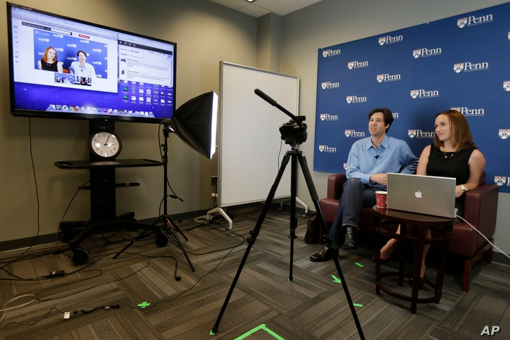 FILE -- University of Pennsylvania professor Peter Struck, accompanied by teaching assistant Cat Gillespie, teaches a mythology class during a live recording of a massive, open, online classes (MOOC), in Philadelphia.