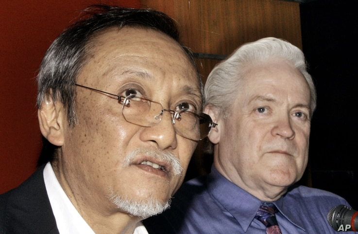 FILE - Thai Senator Kraisak Choonhavan, left, speaks during a joint news conference with William Monson, an American businessman at parliament house in Bangkok, Thailand, May 3, 2006. Monson said he has filed criminal charges against outgoing Prime M...