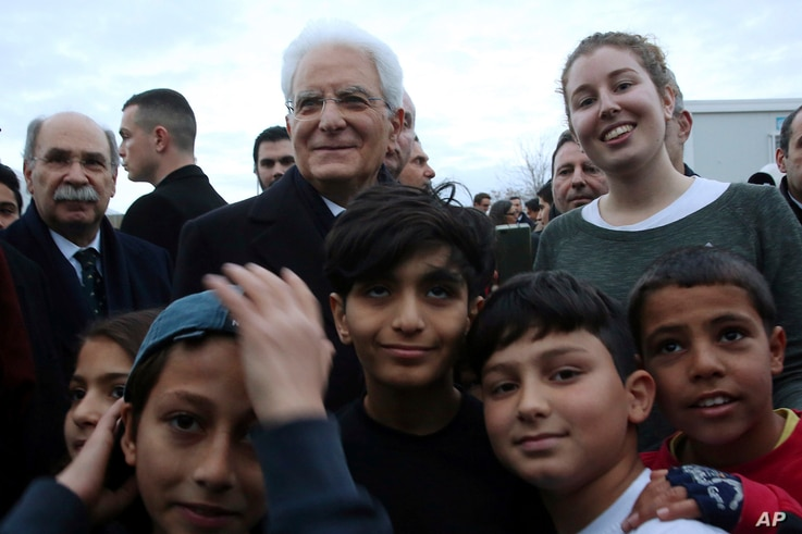 Italian President Sergio Mattarella visits the Elaionas refugee camp, where 2,000 people live in Athens, Jan. 17, 2017. Mattarella is on a two-day official visit in Greece.
