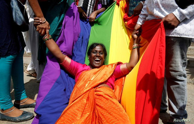 An activist of lesbian, gay, bisexual and transgender (LGBT) community celebrates after the Supreme Court's verdict of decriminalizing gay sex and revocation of the Section 377 law, in Bengaluru, India.