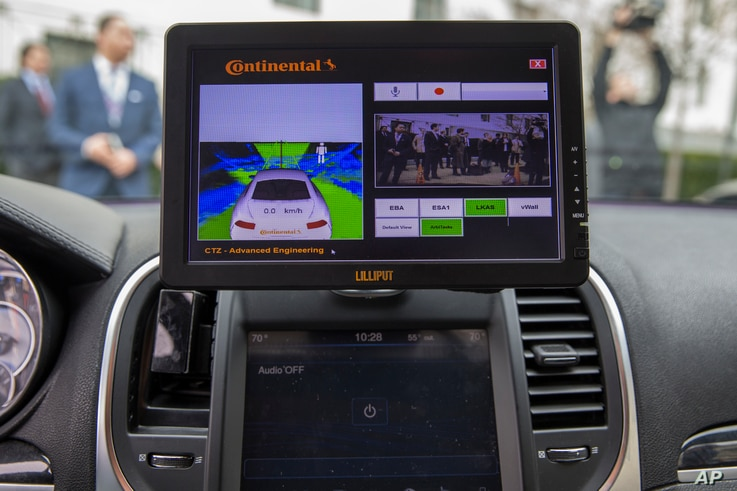 A display inside a Tesla Model 90D during a demonstration of self-driving car technology on Capitol Hill in Washington, March 15, 2016.