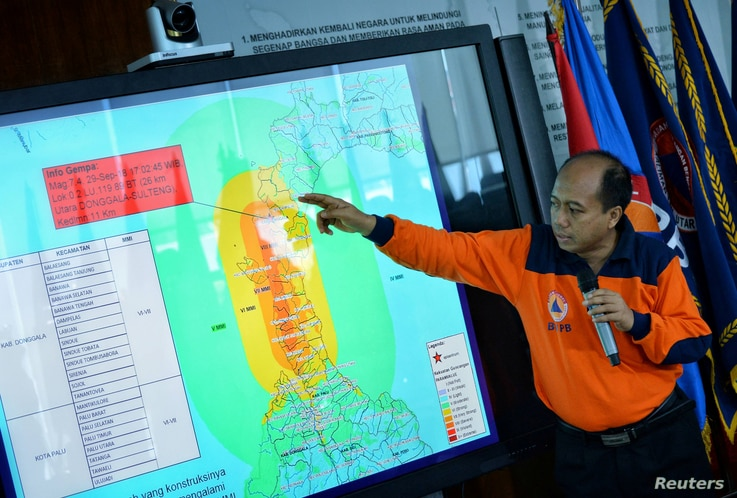 Sutopo Purwo Nugroho, a spokesman of Indonesia's disaster mitigation agency BNPB, holds a news conference to brief reporters on the latest situation after a strong quake and tsunami hit Sulawesi island, at the BNPB headquarters in Jakarta, Indonesia,...
