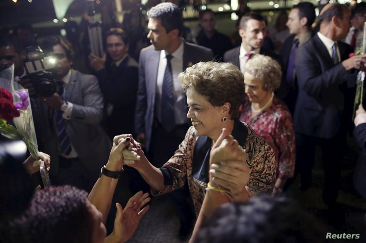 Brazil's President Dilma Rousseff greets women during a rally in support of her and against her impeachment in front of Planalto Palace in Brasilia, April 19, 2016.