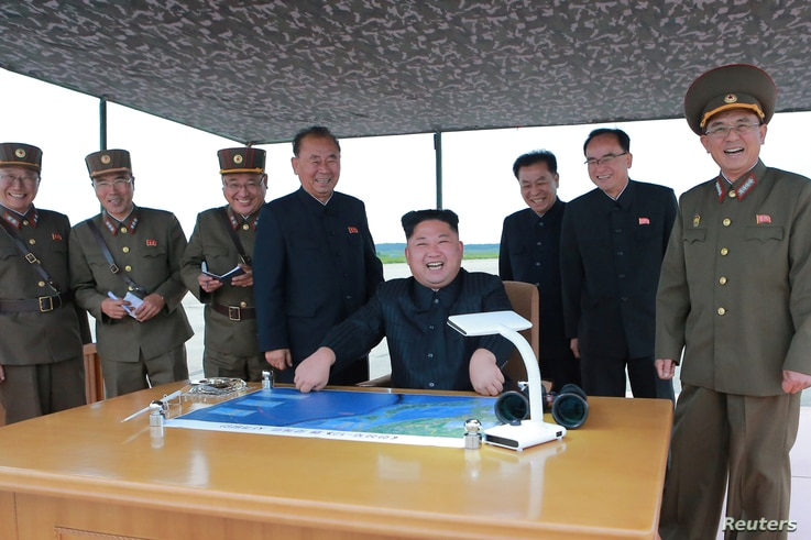 North Korean leader Kim Jong Un inspects a long- and medium-range ballistic rocket launch drill in this undated photo released by North Korea's Korean Central News Agency in Pyongyang, Aug. 30, 2017.