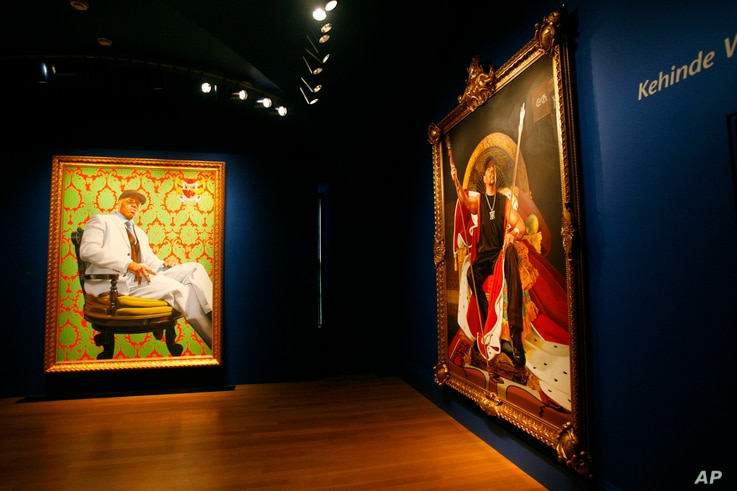 """Paintings of LL Cool J, left, and Ice-T, both by Kehinde Wiley, are part of the exhibit """"RECOGNIZE! Hip Hop and Contemporary Portraiture,"""" at the National Portrait Gallery in Washington, Feb. 5, 2008."""