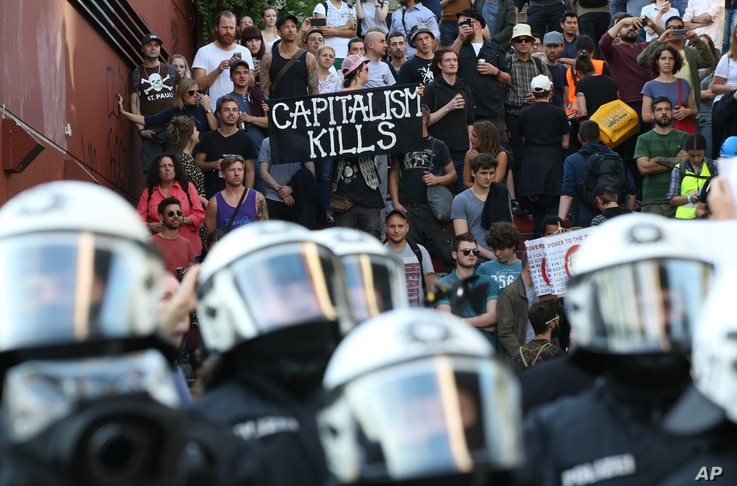Police officers confront a protest against the upcoming G-20 summit in Hamburg, Germany, July 6,  2017.