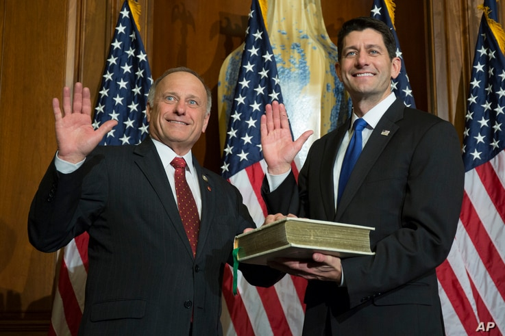 House Speaker Paul Ryan of Wis. administers the House oath of office to Rep. Steve King, R-Iowa., during a mock swearing in ceremony on Capitol Hill, Jan. 3, 2017.