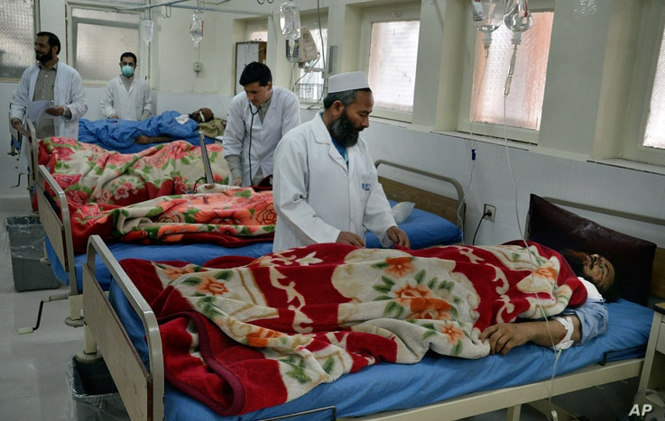 Doctors assist wounded in a hospital after they were injured in a suicide attack, inside a resident house, in Jalalabad, capital of Nangarhar province, Afghanistan, Jan. 17, 2016.