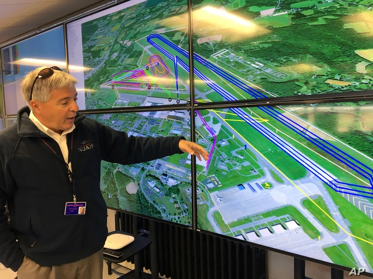 Tony Basile of the Northeast UAS Airspace Integration Research Alliance based at Griffiss International Airport in Rome, N.Y., describes drone test flight paths, Oct. 17, 2017.