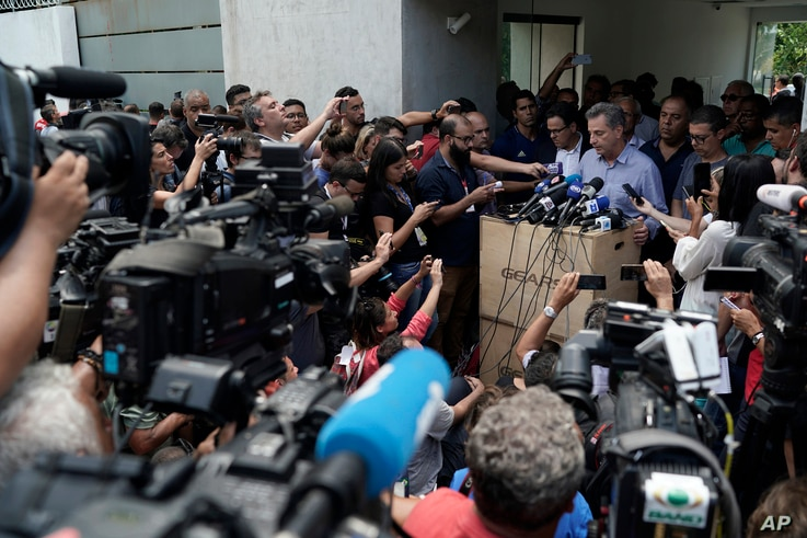 The president of the Flamengo soccer club, Rodrigo Landim, talks to the press after a deadly fire at the soccer club in Rio de Janeiro, Brazil, Friday, Feb. 8, 2019. The fire tore through the sleeping quarters of the club's academy.