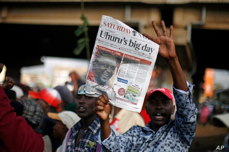 Supporters of Kenyan presidential candidate Uhuru Kenyatta celebrate what they perceive is an election win for him in Nairobi, Kenya, Mar. 9, 2013. Kenya's election commission posted complete results early Saturday showing that Deputy Prime Minister ...