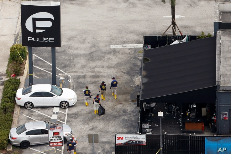 FBI officials approach the Pulse night club, the site of a mass shooting days earlier, in Orlando, Florida, June 15, 2016.