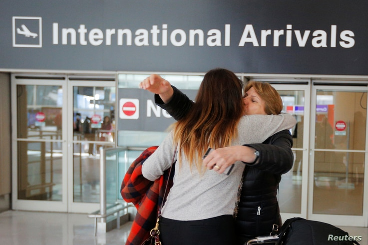 FILE - Mahnaz Kanani Zadeh, right, is greeted by her niece Negin after traveling to the U.S. from Iran following a federal court's temporary stay of U.S. President Donald Trump's executive order travel ban, at Logan Airport in Boston, Massachusetts, ...
