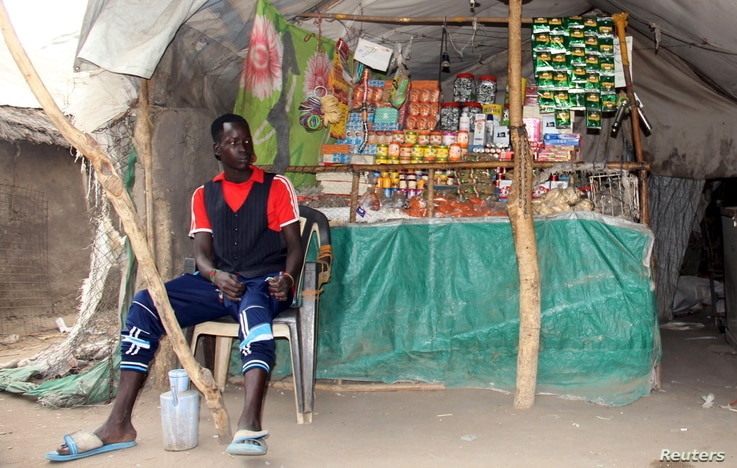A South Sudanese vendor waits for customers at his makeshift shop in the SPLA-IO rebel control area in the Southern part of Unity State Paynjiar County, March 20, 2015.