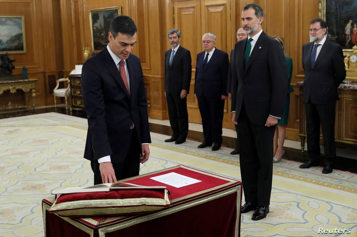 Spain's new Prime Minister and Socialist party leader Pedro Sanchez is sworn in next to King Felipe during a ceremony at the Zarzuela Palace in Madrid, June 2, 2018.