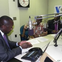 Liberia Planning Minister Amara Konneh (foreground) and Finance Minister Augustine Ngafuan being interviewed by James Butty (center)