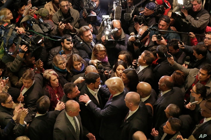 FILE - Republican presidential candidate Donald Trump, foreground right center, met with a coalition of 100 African-American evangelical pastors and religious leaders in a private meeting at Trump Tower in New York, Nov. 30, 2015.