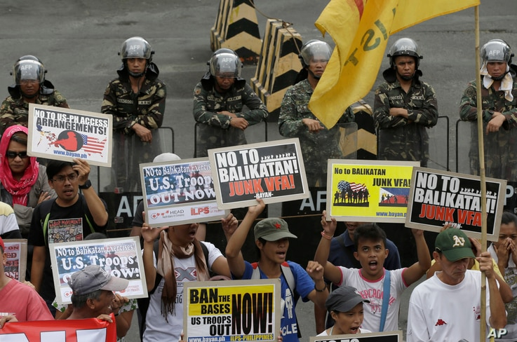 Protesters picket the headquarters of the Armed Forces of the Philippines to coincide with the opening ceremony of the joint U.S.-Philippines military exercise dubbed Balikatan 2014, in Quezon city, northeast of Manila, Philippines, on May 5, 2014.