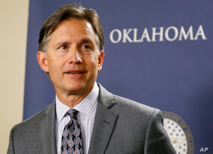 FILE - Oklahoma Attorney General Mike Hunter speaks at a news conference in Oklahoma City, April 26, 2017. Oklahoma is one of at least 13 states that have filed lawsuits against drugmakers, alleging fraudulent marketing of drugs that fueled the opioi...