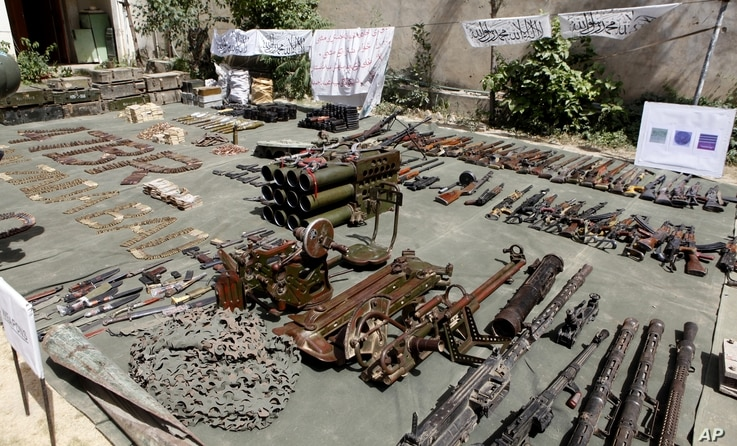 Pakistan army display confiscated ammunition, reportedly from militants Miranshah, after driving out militants from Pakistan's tribal region of North Waziristan along the Afghanistan border, July 9, 2014.