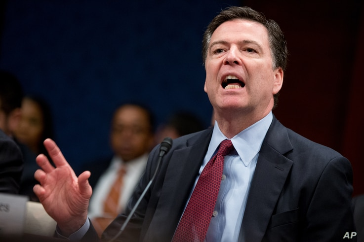 FBI Director James Comey tells the U.S. House Intelligence Committee hearing that the Justice Department's dispute with Apple Inc. represents the 'hardest question I've seen in government,' on Capitol Hill, Washington, Feb. 25, 2016.