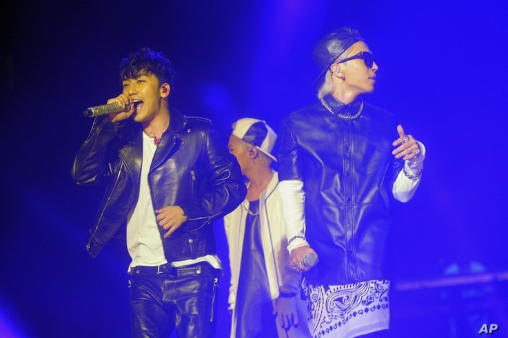 FILE - Korean pop group Big Bang members, from left to right, Seungri, G-Dragon and Taeyang, as they perform in Singapore.