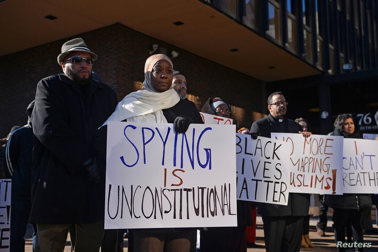 FILE - Kameelah Rashad participates in a rally for Muslim rights outside of the James A. Byrne Federal Courthouse in Philadelphia, Jan. 13, 2015. The rally followed a U.S. Court of Appeals hearing seeking to overturn the dismissal of Hassan v. City o...