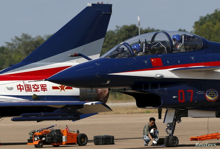 FILE - Pilots of China's J-10 fighter jet from the People's Liberation Army Air Force prepare before a media demonstration at the Korat Royal Thai Air Force Base, Nakhon Ratchasima province, Thailand, Nov. 24, 2015. Bangkok is increasingly looking to...