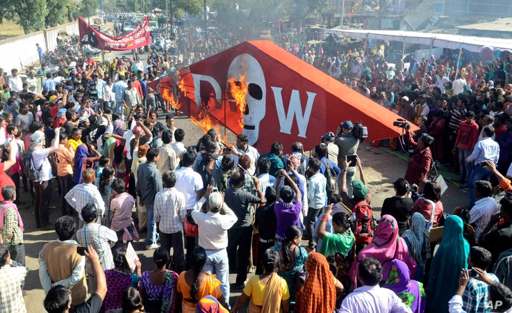 Members of various organizations representing victims of the Bhopal gas tragedy burn an effigy of Dow Chemical Co., which bought Union Carbide, on the 30th anniversary of the Bhopal gas tragedy in Bhopal, India, Dec. 3, 2014.
