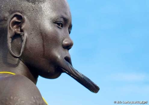 The most well-known of the Omo River tribes are the Mursi, whose women use plates to extend their lips