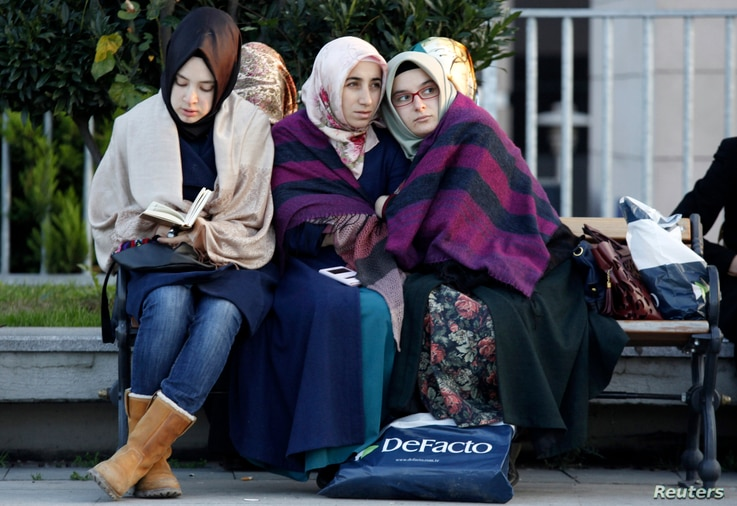 Relatives and supporters of people who were detained wait outside the Justice Palace in Istanbul December 14, 2014. Turkish police raided media outlets close to a U.S.-based Muslim cleric on Sunday and detained 24 people including top executives and ...
