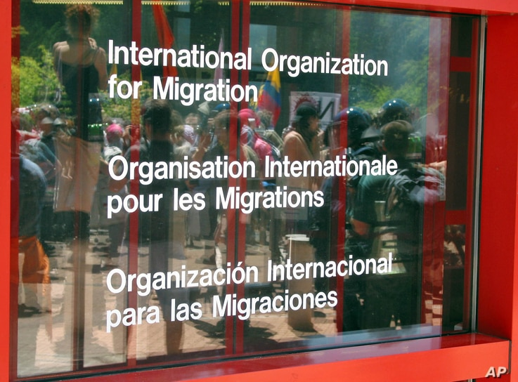 FILE - The office of the International Organization for Migration in Geneva, May 30, 2003.