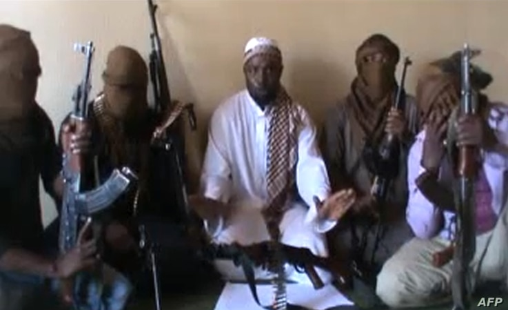 In a April 12, 2012 screengrab, Boko Haram leader Abubakar Shekau (C) is sitting flanked by militants. Nigeria's military said it had killed the second-in-command of Islamist group Boko Haram while repelling an insurgent attack earlier this month.