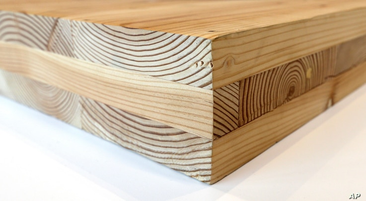 FILE - A piece of cross-laminated timber in Portland, Ore., Nov. 15, 2016. CLT is made up of 2-by-4 beams laid out in perpendicular layers that are then glued together to make giant panels.