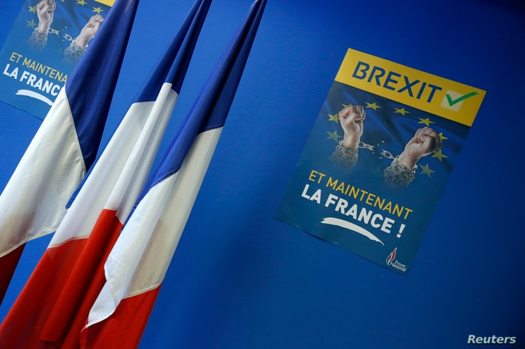 """A poster which reads """"Brexit, And now France"""" is seen near French flags before a news conference at the France's far-right National Front political party headquarters in Nanterre near Paris after Britain's referendum vote to leave the European Union,..."""