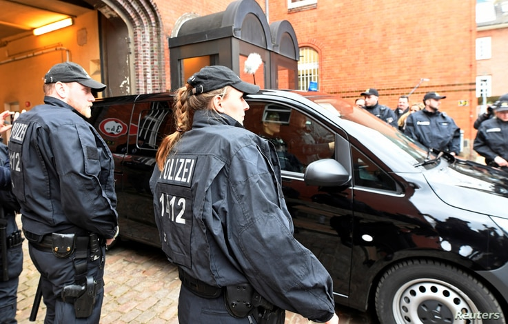 A vehicle, believed to carry detained former Catalan leader Carles Puigdemont, leaves the prison in Neumuenster, March 26, 2018.