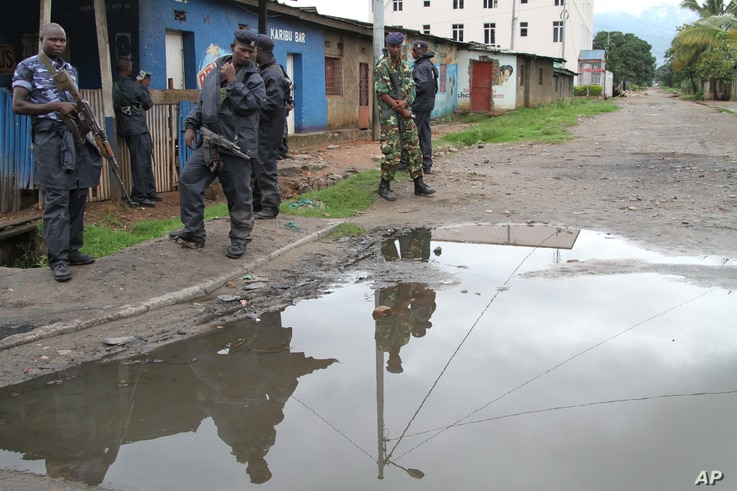 Burundian police and soldiers guard a deserted street in Bujumbura, Burundi, Sunday, Nov. 8, 2015. Rising violence in Burundi is sparking calls for greater international attention.