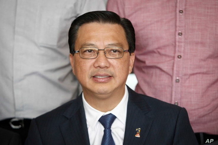 In this photo taken on March 3, 2016, Malaysian Transport Minister Liow Tong Lai poses for photographs prior to a press conference in Kuala Lumpur, Malaysia. Liow says two plane pieces found in Mozambique will be sent to Australia to verify if they b...